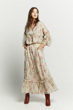 Conjunto de blusa, falda estampado vintage y botas altas